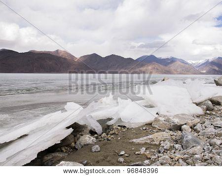 Ice Lake In Mountain Range And Rain Clouds Background,  Ladakh, India