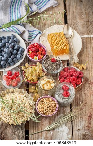 cereal and various delicious ingredients for breakfast, vertical, top view