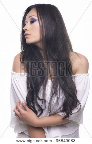 Side Portrait Of A Model With Long Black Hair