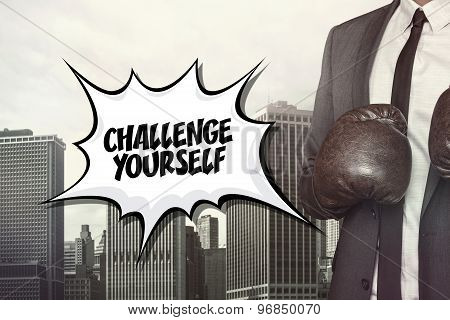 Challenge yourself text with businessman wearing boxing gloves