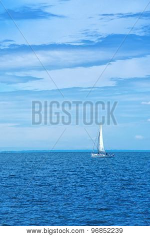Boat Sailing At Blue Sea