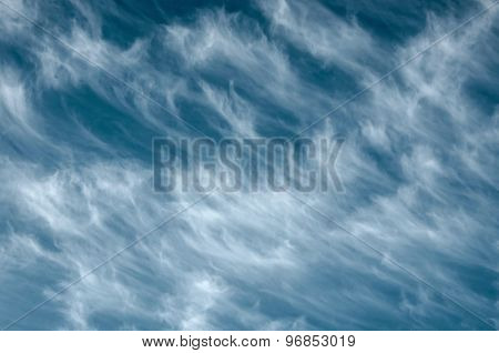 beautiful fluffy clouds on a blue sky as background