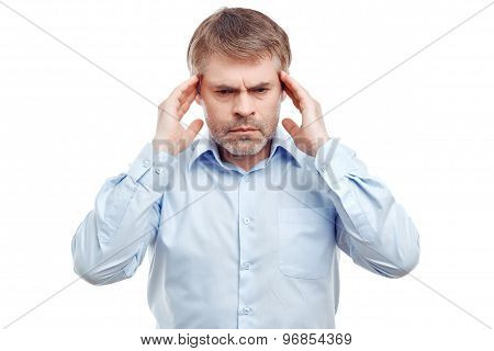 Upset man touching his temples.