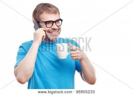 Cheerful man drinking tea