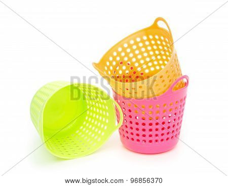 Small And Colorful Baskets On A White Background