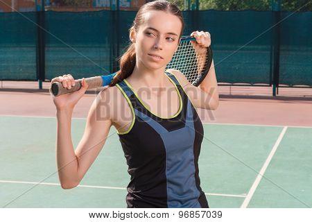 Nice woman holding racket