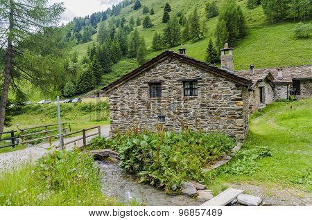 Stone houses in Alpine village shepherd's  Italy