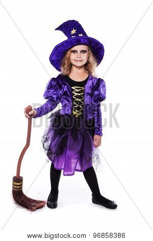 Adorable little blond girl wearing a witch costume smiling at the camera. Halloween. Fairy. Tale