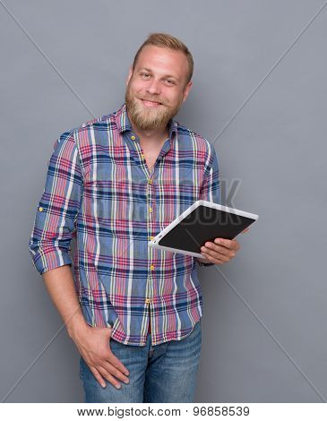 Bearded man with tablet PC