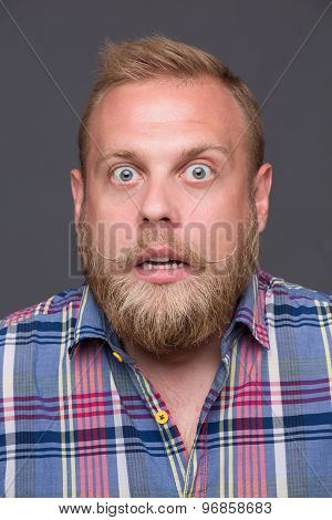 Astonished bearded man