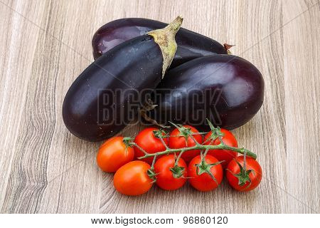 Eggplant And Tomatoes On The Branch