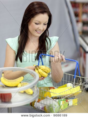 Healthy Woman Buying Bananas In A Grocery Shop