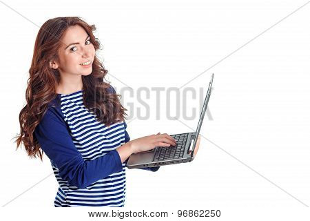 Smiling girl holding laptop