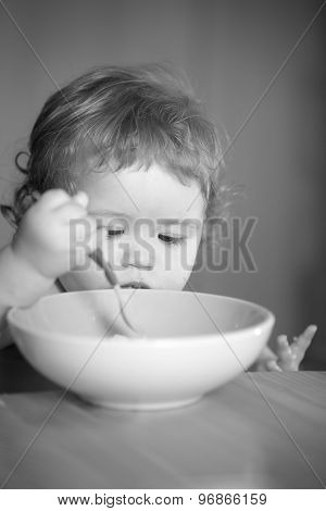 Portrait Of Curious Male Kid Eating
