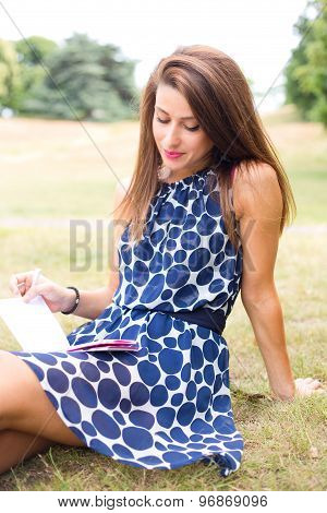 reading notes in the park