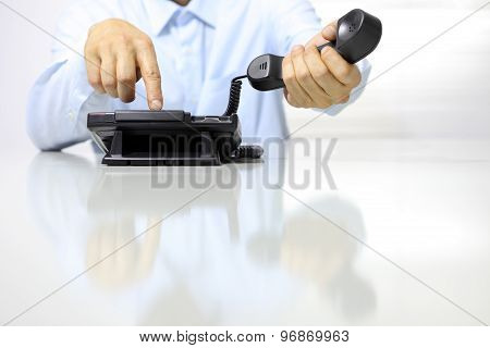 Hands With Office Phone On Desk