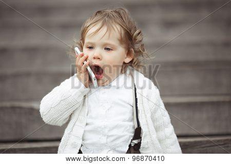 Little girl talking on mobile phone