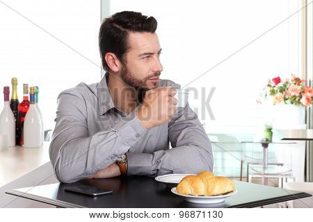 Handsome Man Drinking A Cup Of Coffee At The Bar