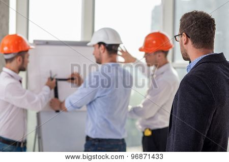 Successful construction team is working on a project
