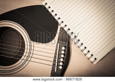 Notebook On Guitar Background