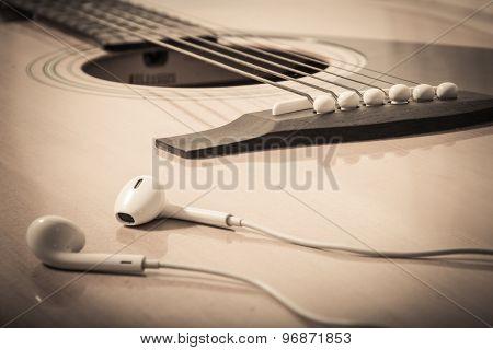 Headphone On Guitar Background