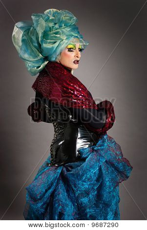 Drag queen on gray background
