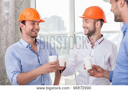 Attractive young construction team is resting after hard work