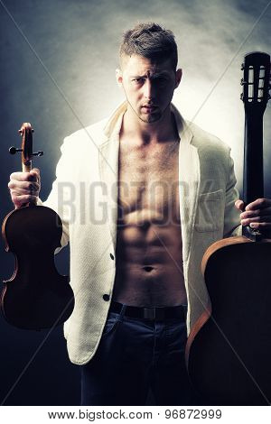 Attractive Man With Guitar And Violin