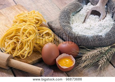 tagliatelle and ingredients with background