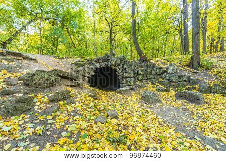 Stone grotto in the autumn park