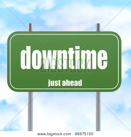 Green Road Sign With Downtime Word
