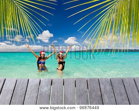 Two Funny Girls In Santa Hat On Beach