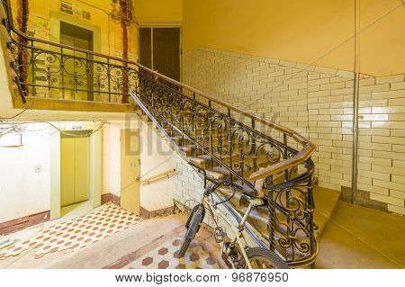 staircase with a handrail in the stairwell of an apartment house