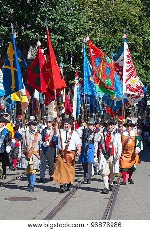 ZURICH - AUGUST 1: Swiss National Day parade on August 1, 2012 in Zurich, Switzerland. Representatives of  professional guilds in a historical costumes.