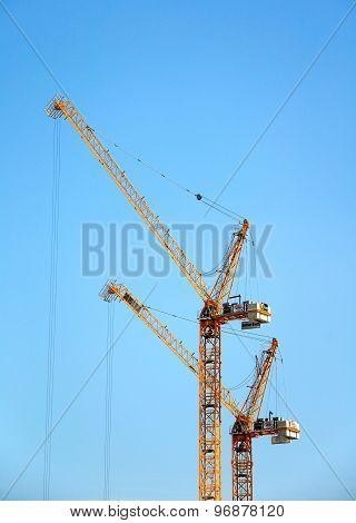 Construction cranes.
