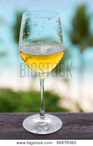 Glass Of White Wine On Balcony Rail