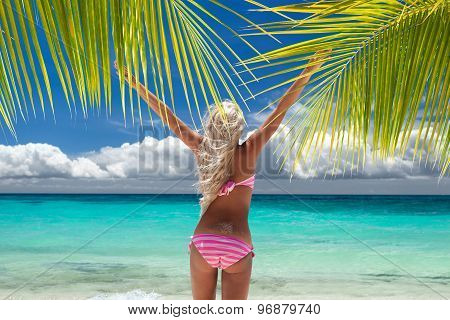 Woman In Bikini With Outstretched Arms On Tropical Beach