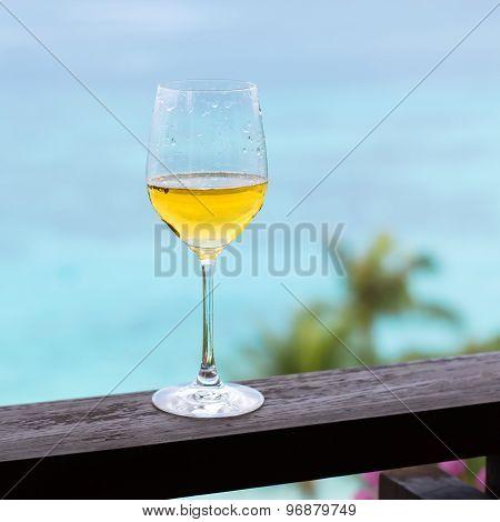 Glass Of White Wine On Balcony Rail