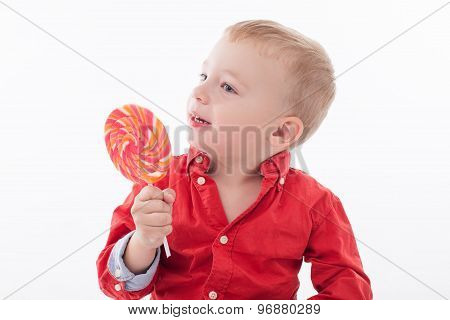 Cute little child is enjoying sweet candy