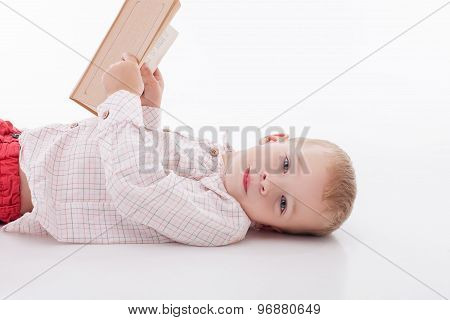 Cheerful little male child is learning letters