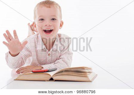 Cheerful little child is choosing new equipment