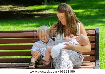 Mother With Newborn Baby And  Son