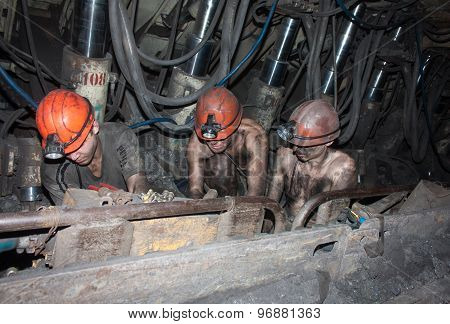 Novogrodovka, Ukraine - January 18, 2013: Miners Are Busy Repairing Work Equipment