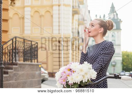 Cheerful young woman is sightseeing in town