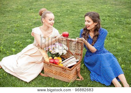 Cheerful young girls are relaxing in the nature