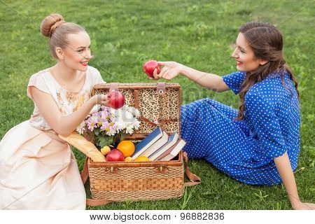 Cheerful young women are relaxing in the nature