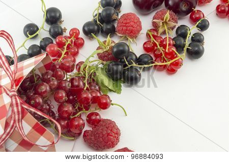 Colorful Red Berry Fruit Falling Out Of Decorated Box On White
