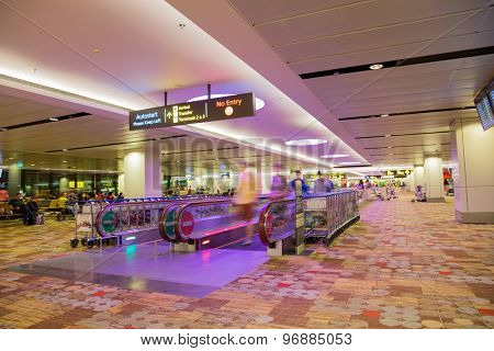 SINGAPORE - JANUARY 26, 2015: Changi International Airport is a major aviation hub in Asia, serves more than 100 airlines operating 6,100 weekly flights connecting Singapore to over 220 cities.