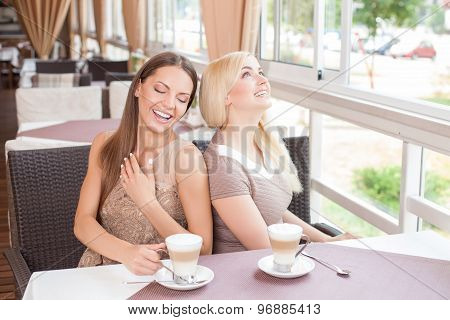 Pretty young women are resting in cafe