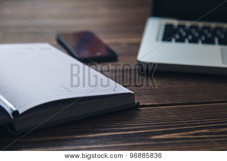 Laptop and diary on the desk